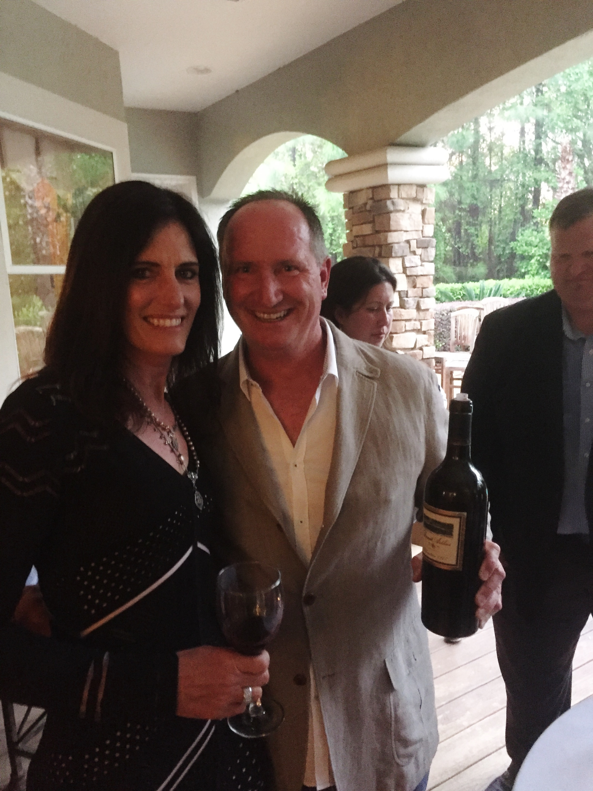 """Dean and Laurie Gray from Riverain Vineyards holding a bottle of """"Elevation"""" from fellow Vintner David Arthur Long"""